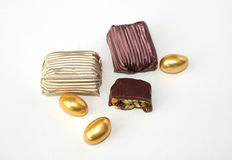 Chocolate candy. Candy in foil, cut candy and golden eggs chocolate Royalty Free Stock Image
