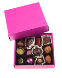 Chocolate candy. Group in pink box on white Royalty Free Stock Images