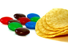 Chocolate Candy. Close up Color Chocolate Candy with potato chips Stock Image