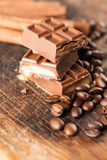 Chocolate candy bar and cofee beans Royalty Free Stock Photography