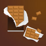 Chocolate candy bars. A view of partially opened wrappers of chocolate candy bars on a brown gradient background Royalty Free Stock Photo