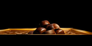 Chocolate candy. On a black background. macro shooting Stock Photos
