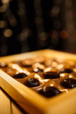 Chocolate candy. On a black background. macro shooting. flash. new Year. gift Royalty Free Stock Image