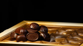 Chocolate candy. On a black background. macro shooting. flash. new Year. gift Royalty Free Stock Photo