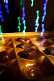 Chocolate candy. On a black background. macro shooting. flash. new Year. gift Royalty Free Stock Photography