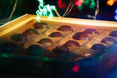 Chocolate candy. On a black background. macro shooting. flash. new Year. gift Royalty Free Stock Photos