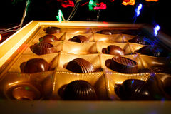 Chocolate candy. On a black background. macro shooting. flash. new Year. gift Stock Photo