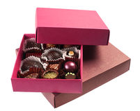 Chocolate candy in box. Chocolate candy group in purple box on white Stock Image