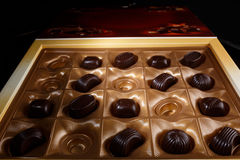 Chocolate candy in a box. On a black background. macro shooting. flash. new Year. gift Royalty Free Stock Photo