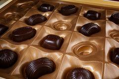 Chocolate candy in a box. On a black background. macro shooting. flash. new Year. gift Royalty Free Stock Photography