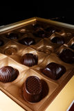 Chocolate candy. In a box. on a black background. macro shooting. flash. new Year. gift Stock Photography