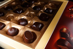 Chocolate candy. In a box. on a black background. macro shooting. flash. new Year. gift Stock Photos