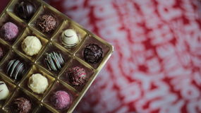 Chocolate candy box on a decorative red and white tablecloth Royalty Free Stock Images