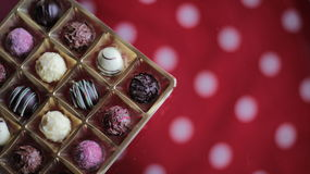 Chocolate candy box on a dotted tablecloth Stock Photography