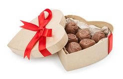 Chocolate candy in a box with a red bow Royalty Free Stock Photo