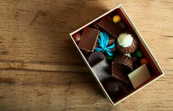 Chocolate candy in box on wood royalty free stock photos