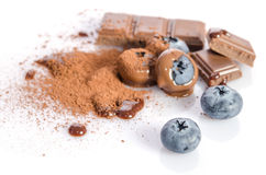 Chocolate candy, and cacao powder with blueberry Royalty Free Stock Photos
