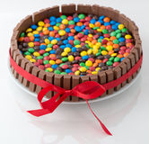 Chocolate candy cake. Attached with a ribbon Royalty Free Stock Photos