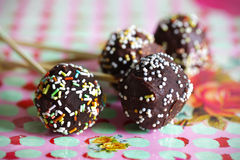 Chocolate candy cake pops with sprinkles Royalty Free Stock Images