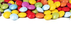Chocolate candy candies background smarties on isolated white studio background. Closeup photo. Clipping path. Easy to Royalty Free Stock Photography