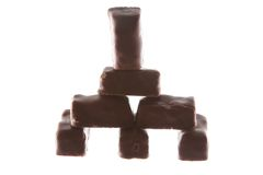 Chocolate candy castle or house. Isolated on the white background royalty free stock photos