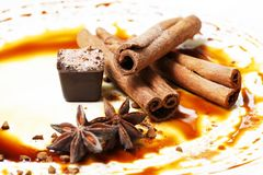 Chocolate candy. Isolated with anice and cinnamon Stock Photo