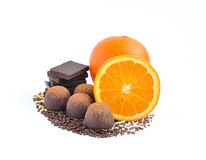 Chocolate candy, chocolate and orange on a white Stock Images