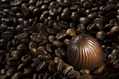 Chocolate candy and coffee beans Stock Photo