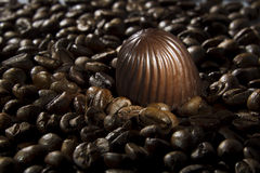 Chocolate candy and coffee beans Stock Photography