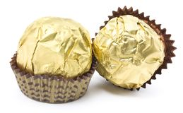 Chocolate candy couple. In the gold cover on the white background Stock Images