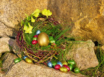 Chocolate candy Easter eggs in nest Stock Photos