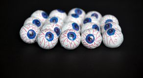 Chocolate candy eyeballs arranged as a background for Halloween Royalty Free Stock Photos
