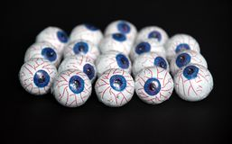 Chocolate candy eyeballs arranged as a background for Halloween Royalty Free Stock Photo