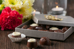 Chocolate candy and flowers Royalty Free Stock Image