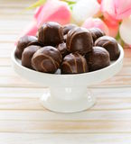 Chocolate candy and flowers Stock Photo