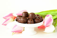 Chocolate candy and flowers Stock Images