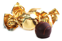 Chocolate candy in golden wrapper. Close up Stock Image