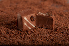 Chocolate candy on grated chocolate background Royalty Free Stock Photography