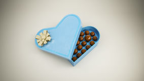 Chocolate candy in heart. Chocolate candy in a box in the shape of heart Royalty Free Stock Photography