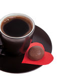 Chocolate candy at the heart of paper and coffee black Stock Images