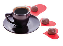 Chocolate candy at the heart of paper and coffee black Royalty Free Stock Photo