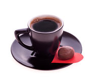 Chocolate candy at the heart of paper and coffee black Stock Image