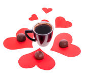 Chocolate candy at the heart of paper and coffee black Royalty Free Stock Photos