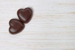 Chocolate candy hearts on a wooden background Stock Photo