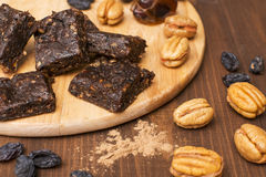 Chocolate candy at home with dates. Nuts and raisins Stock Photo
