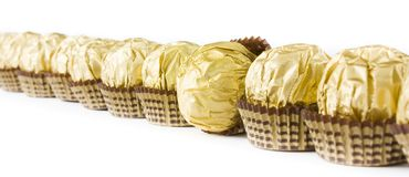 Chocolate candy line. In the gold cover on the white background Stock Images