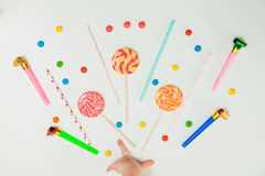 Chocolate Candy Lollipop Hand White Background Lay Flat Minimal. Chocolate Candy Lollipop Child Hand White Background Lay Flat Minimal Pattern Holiday Concept Royalty Free Stock Photo