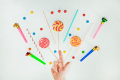 Chocolate Candy Lollipop Hand White Background Lay Flat Minimal. Chocolate Candy Lollipop Female Hand White Background Lay Flat Minimal Pattern Holiday Concept Stock Image