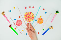 Chocolate Candy Lollipop Hand White Background Lay Flat Minimal. Chocolate Candy Lollipop Female Hand White Background Lay Flat Minimal Pattern Holiday Concept Royalty Free Stock Photos