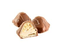 Chocolate candy with milk cream and nuts Royalty Free Stock Images